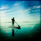 A Ten Year Old Boy on a Stand Up Paddle Board Off Orr's Island Fotografisk tryk af Skip Brown