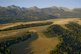 Meadows and Grazing Lands Stretch Below Montana's Crazy Mountains Photographic Print by Gordon Wiltsie