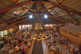 Tourists Eat in the Historic Dining Room at Old Faithful Inn Photographic Print by Gordon Wiltsie