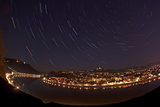 Linz at Night with Star Trails, Orion, Winter Triangle, Cassiopeia, and Polaris Photographic Print by Babak Tafreshi