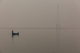With Communication Towers Looming in the Background, Two Men Float Down the Ganges River Photographic Print by Greg Davis