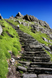 A Tourist Climbs Steps to Bee Hive Huts on Skellig Michael, County Kerry, Ireland Photographic Print by Chris Hill