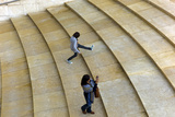 Two People Walking Up Stairs at the Guggenheim Museum Bilbao Photographic Print by Tino Soriano
