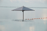 An Umbrella and an Infinity Pool at a Resort on Bora Bora Island Photographic Print by Karen Kasmauski