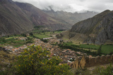 Ruins of an Incan Fortress Cling to a Steep Hillside Above Ollantaytambo Lámina fotográfica por Beth Wald