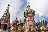 The Colorful Onion Domes of Saint Basil's Cathedral Stand Against a Blue Sky Photographic Print by Kent Kobersteen