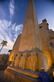 A Man Stands Next to an Illuminated Obelisk at Luxor Temple Fotografie-Druck von Michael Melford