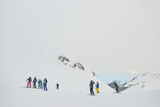 A Colorful Group of Skiers at Col Rodella in the Italian Dolomites Photographic Print by Alex Treadway