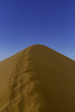 Human Footprints Along the Crest of Mountainous Dune 45 Photographic Print by Jonathan Irish