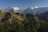 Snow-Capped Peaks of the Urubamba Range Tower over Terraced Fields on Steep Hillsides Photographic Print by Beth Wald