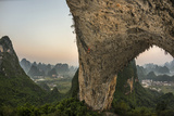 A Climber Scales Moon Hill, an Arch from the Remains of a Collapsed Cave Photographic Print by Peter Carsten