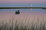 Moonrise at Sunset and a Lone Boat in Salt Pond Bay, Eastham, Cape Cod, Massachusetts Fotografisk tryk af Michael Melford