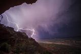 Lightning Strikes Above the Rich Badlands of Grand Staircase-Escalante National Monument Photographic Print by Cory Richards
