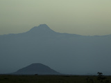 View from Chyulu Hills Looking Towards Mount Kilimanjaro, in Silhouette Photographic Print by Beverly Joubert