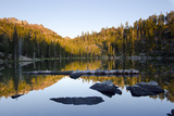 Sunrise on the Sierra Buttes Reflecting in Volcano Lake Photographic Print by Rich Reid