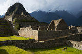 A Llama Grazing Among Ancient Inca Masonry at Machu Picchu Photographic Print by Diane Cook Len Jenshel