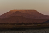 Twilight Paints a Flat-Topped Mountain Red in a Desert Landscape Photographic Print by Jonathan Irish
