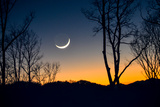 A Crescent Moon Hangs Low in the Sky over the Blue Ridge Mountains, Just after Sunset Photographic Print by Amy and Al White and Petteway