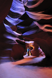 A Woman Exploring Antelope Canyon Photographic Print by Keith Ladzinski