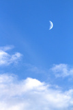 Crescent Moon and Clouds in a Blue Sky Photographic Print by Sean Gallagher