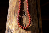 Prayer Beads Hang on a Post in a Buddhist Monastery Photographic Print by Sean Gallagher