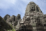 Carved Faces Dominate Bayon, the Premier Temple Within Angkor Thom Photographic Print by Scott S. Warren