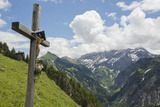 A Crucifix, or Materl, on a Hillside in an Austrian Alp Valley Photographic Print by Ulla Lohmann