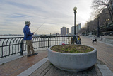 A Man Fishes in New York City's East River with His Dog Photographic Print by Gordon Wiltsie