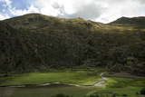 Bright Green Fields Along the Patacancha River Below Hillside Ancient Terraces Photographic Print by Beth Wald