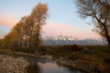On a Fall Morning, the First Light Hits the Clouds Above the Grand Tetons Photographic Print by Barrett Hedges