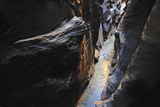 Looking Down into a Water-Filled Slot Canyon Photographic Print by Keith Ladzinski