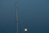 Moon and Sailboat Mast at a Marina on Kent Island on Maryland's Eastern Shore Photographic Print by Karen Kasmauski