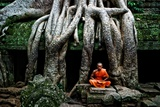 A Theraveda Buddhist Monk at the Ta Prohm Temple in the Angkor Complex Photographic Print by Kike Calvo