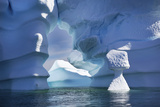 Blue Icebergs Including an Arch, Sculpted by Waves and Melting Photographic Print by Ira Meyer
