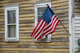 An American Flag Hangs from a House in Tylerton Photographic Print by Karen Kasmauski