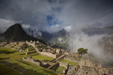 A Rainbow Emerges from the Clouds over Machu Picchu Photographic Print by Michael Melford