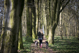 A Young Girl with Her German Shorthaired Pointer in the Woods Photographic Print by Alex Treadway