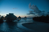 Resort Cottages at Sunset on Bora Bora Photographic Print by Karen Kasmauski