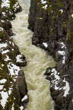 Yellowish Water Flowing Through a Snow-Dusted Gorge Photographic Print by Jed Weingarten