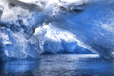 An Iceberg Arch Through Intensely Blue Icebergs Photographic Print by Ira Meyer