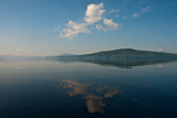The Sky Is Reflected in the Surface of a Lake Photographic Print by Heather Perry