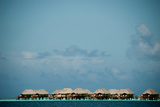 Vacation Cottages over Water on Bora Bora Photographic Print by Karen Kasmauski