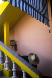 A Man in a Hat by a Staircase at a Guest House Photographic Print by Tino Soriano