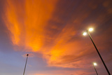 Bright Orange Illuminated Clouds During Sunset Photographic Print by Mike Theiss