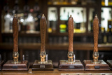 Beer Pumps in a Pub in Scotland Photographic Print by Alex Treadway
