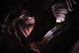 Sunlight Through Ancient Water Eroded Canyons Photographic Print by Keith Ladzinski