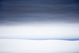 A Glaciated Hillside under a Sky Blanketed with Clouds Photographic Print by Ira Meyer