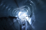 A Tunnel of Melt-Sculpted Blue Glacier Ice Photographic Print by Keith Ladzinski