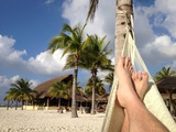 Relaxing in a Hammock on the Beach in Cozumel Photographic Print by Andrew Evans
