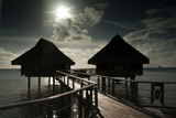 Cottages Above the Lagoon on the Island of Bora Bora Reproduction photographique par Karen Kasmauski
